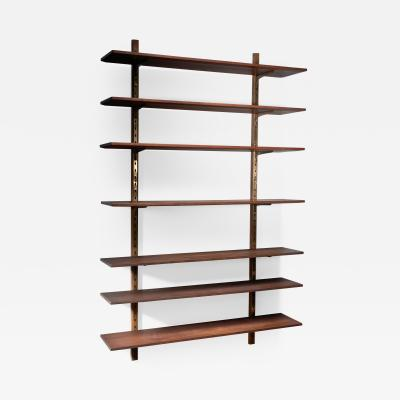 Large shelving unit with brass brackets