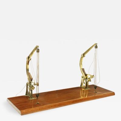 Late 19th century model of a pair of brass Davit type cranes