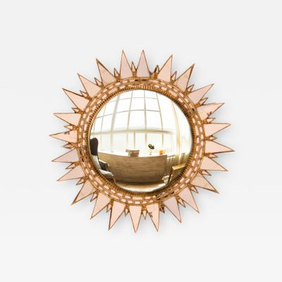 Line Vautrin A champagne colored starburst mirror in the manner of Line Vautrin