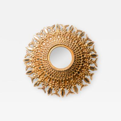 Line Vautrin A large round segmented and carved giltwood mirror in the manner of Line Vautrin