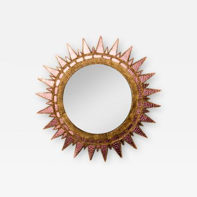 Line Vautrin A shimmery pink colored glass mirror in the manner of Line Vautrin