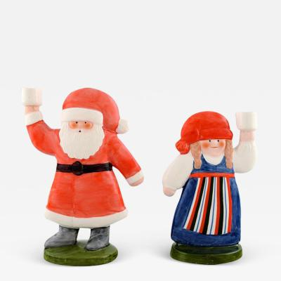 Lisa Larson A pair of rare candlesticks in glazed porcelain Santa and his wife