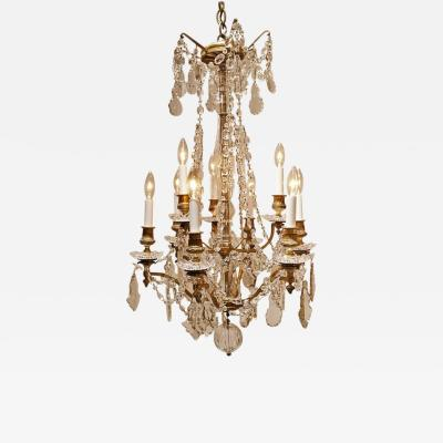 Louis XV Style Nine Light Gilt Bronze and Crystal Chandelier