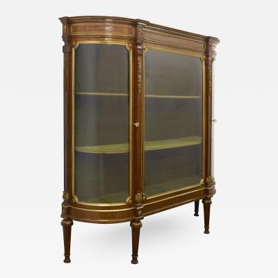Louis XVI style satinwood vitrine with Neoclassical ormolu mounts