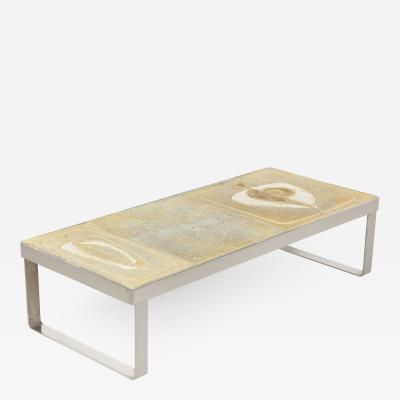 Low table with polished nickel base and cream ceramic top