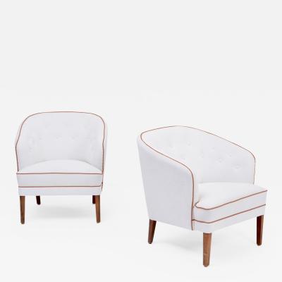 Ludvig Pontoppidan Pair of white reupholstered Danish Mid Century armchairs by Ludvig Pontoppidan