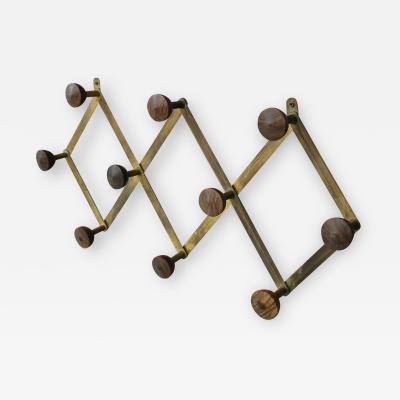 Luigi Caccia Dominioni Hanging clothes by Luigi Caccia Dominioni in brass and wood 1950s