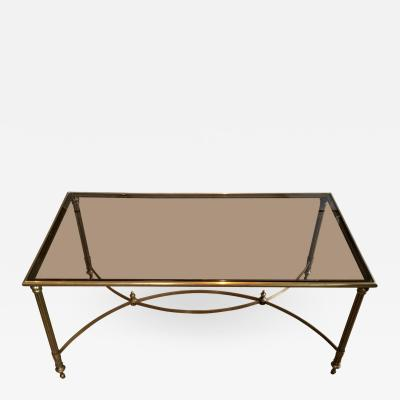 MID CENTURY BRASS SMOKED GLASS COFFEE TABLE WITH CURVED STRETCHER
