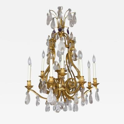 Maison Bagu s French Rock Crystal and Gilt Bronze Twelve Light Chandelier