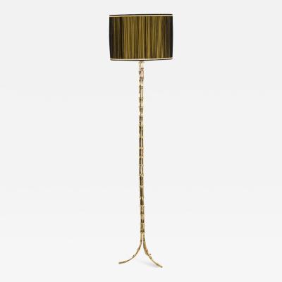Maison Bagu s Tripod floor lamp imitating bamboo in gilt bronze 1970s