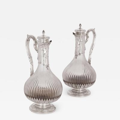 Maison Boin Taburet Two Neoclassical style silver and crystal claret jugs