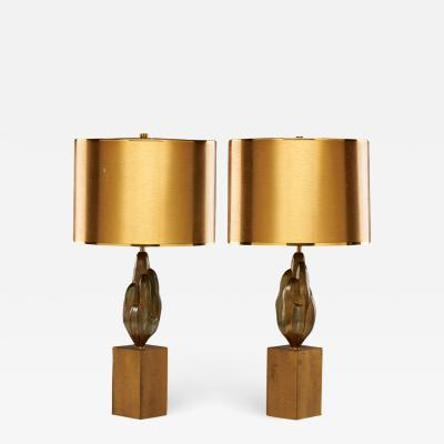 Maison Charles Fine and rare pair of patinated bronze table lamps by Maison Charles