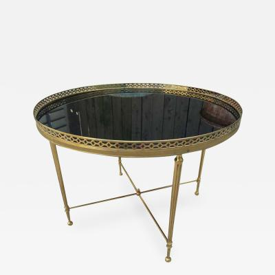 Maison Jansen ROUND COFFEE TABLE WITH BLACK OPALINE GLASS AND GALLERY TOP