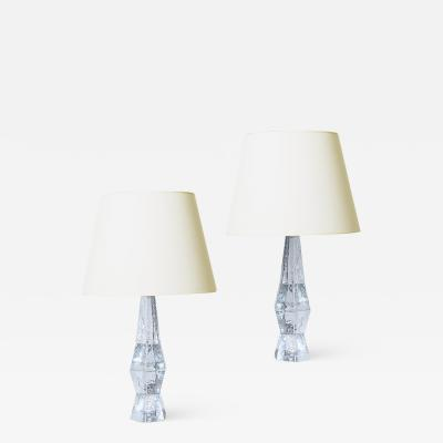 Mantorp Glasbruk Pair of Brutalist table lamps in textured and cast crystal by Mantorp Glasbruk