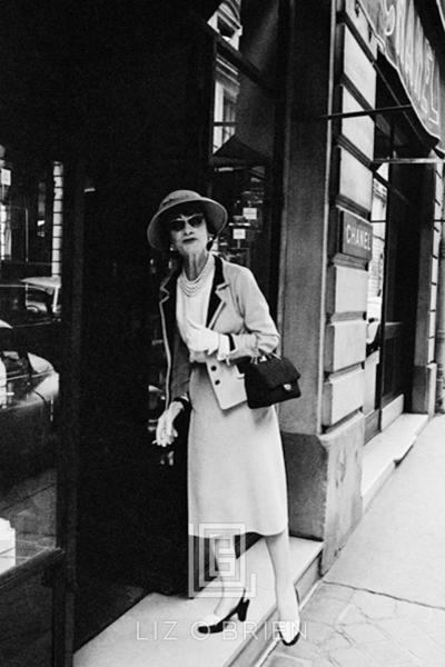 Mark Shaw Coco Chanel Enters her Shop on the Rue Fauborg St Honore