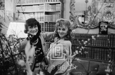 Mark Shaw Coco Chanel and Jeanne Moreau Behind Flowers