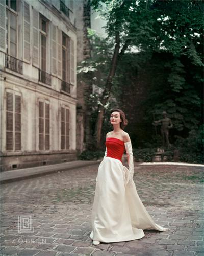 Mark Shaw Red and White Satin Balenciaga Gown in Paris Courtyard
