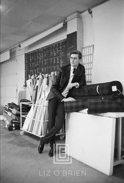 Mark Shaw Yves St Laurent Leans on Bolts of Fabric