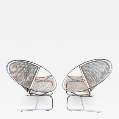 Maurizio Tempestini Lovely Pair of Maurizio Tempestini for Salterini Circular Radar Saucer Chairs