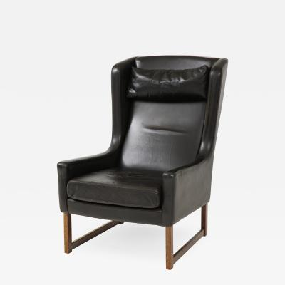Mid 20th Century Black Leather Wing Chair