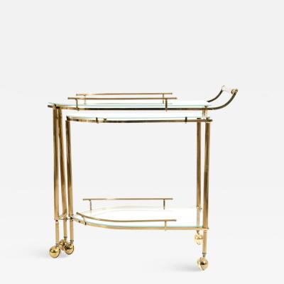 Mid 20th Century Brass Glass Three Tier Swivel Wheeled Bar Cart