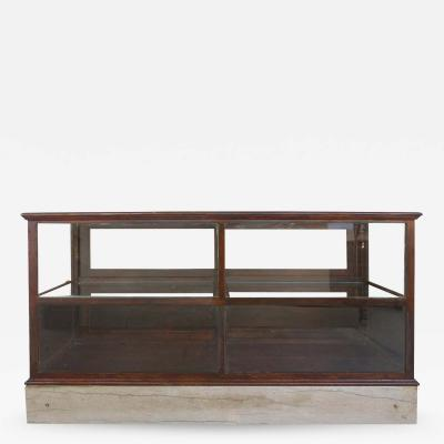 Mid Century Modern Wood Glass Showcase Counter With Stone Supports at Base