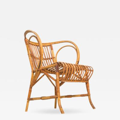 Mid Century Modern by R Wengler Wicker Rattan Chair Denmark 1960s