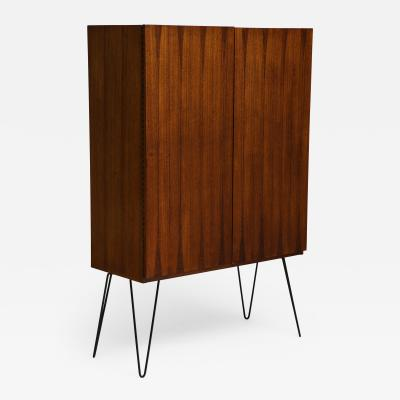 Minimalist mahogany cabinet with subtle rosewood inlay