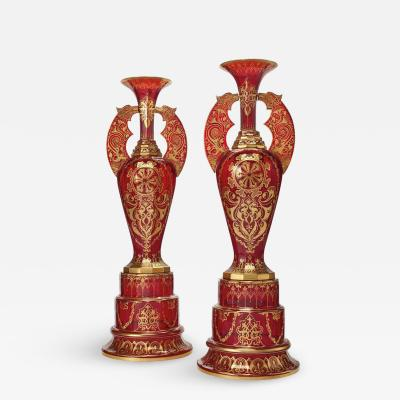 Monumental Pair of Ruby Red Gilt Bohemian Alhambra Cut Glass Vases on Stands
