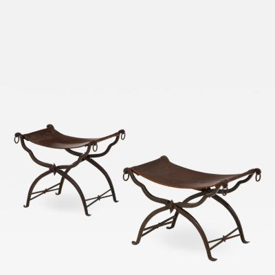 Morgan Colt Pair of wrought iron and leather curule stools by Morgan Colt