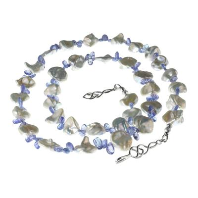 Necklace of Glowing White Keshi Pearls and Sparkling Purple Tanzanite briolettes