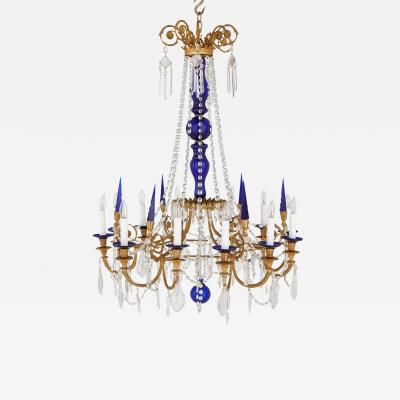 Neoclassical style gilt bronze clear and blue cut glass chandelier