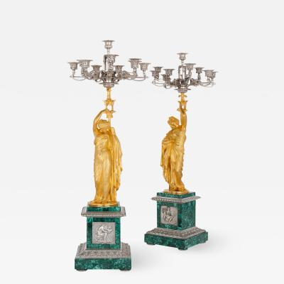 Neoclassical style malachite silvered and gilt bronze clock set