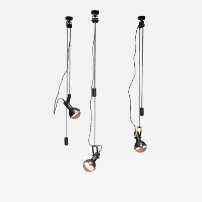 Oscar Torlasco Set of three Oscar Torlasco pendants with counterweight