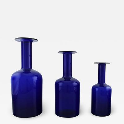 Otto Brauer Three large vases bottles in dark blue art glass