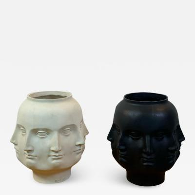 PAIR OF BLACK WHITE PERPETUAL FACE VASES IN THE MANNER OF FORNASETTI