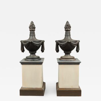 PAIR OF CAST IRON URN FINIALS WITH FLAME TOPS AND SWAGS