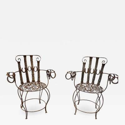 PAIR OF FOLK ART IRON CACTUS WOOD CHAIRS