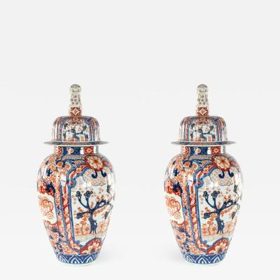 PAIR OF JAPANESE IMARI ROSE PORCELAIN COVERED VASES