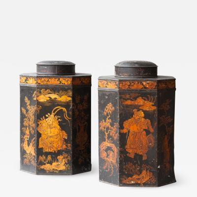 PAIR OF OCTAGONAL REGENCY TOLE TEA CANISTERS AND COVERS IN CHINOISERIE STYLE