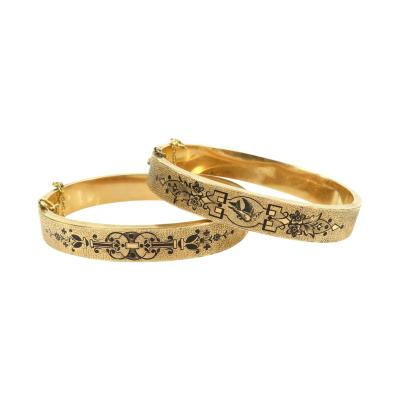 PAIR OF VICTORIAN ENAMEL HINGED BRACELETS