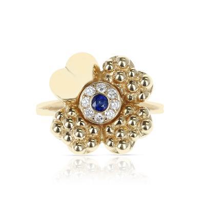PARIS CLOVER RING WITH DIAMONDS AND CENTER BLUE SAPPHIRE 18 KARAT YELLOW GOLD