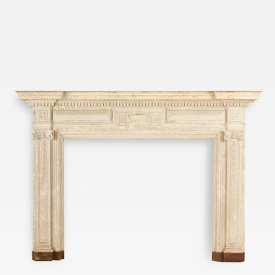 Painted fireplace mantel with restrained use of classical elements