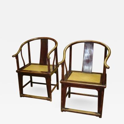 Pair Chinese horseshoe back chairs