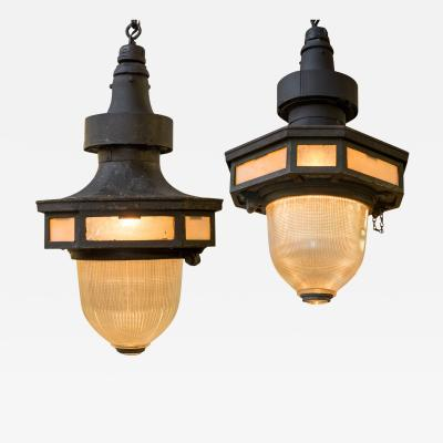 Pair of 1920s Cast Iron Stained Glass Surrounding Holophane Street Pendants