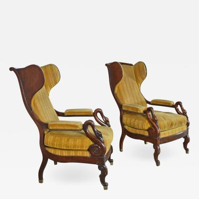 Pair of 19th Century French Empire Mahogany Wing Back Armchairs