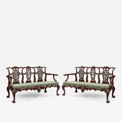 Pair of Antique Carved Mahogany Settees in the Chippendale Manner