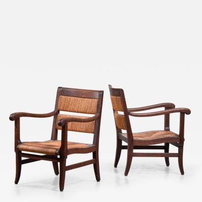 Pair of Arts Crafts armchairs