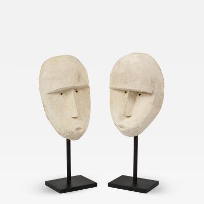 Pair of Balinese carved modernist plaster mask sculptures