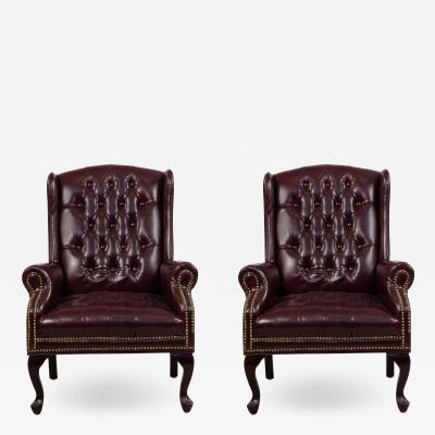 Pair of Burgundy Tufted Leather Wing Back Chairs